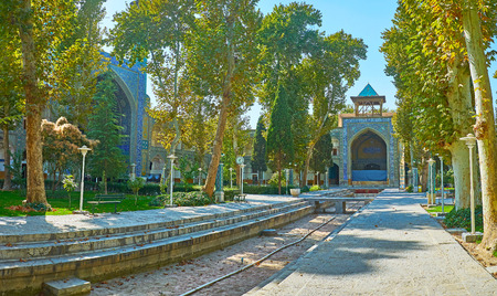 The walk along the fountain of Chaharbagh Theological School, famous as Four Gardens madraseh and located in old town of Isfahan, Iran.