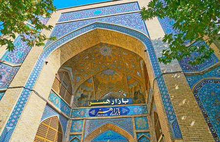 ISFAHAN, IRAN - OCTOBER 20, 2017: The entrance portal of Honar Bazaar, the medieval part of Chaharbagh complex, on October 20 in Isfahan.