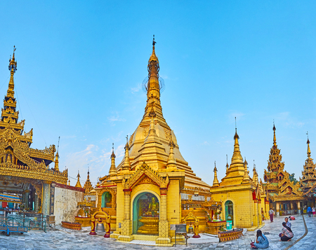 YANGON, MYANMAR - FEBRUARY 14, 2018: Panorama of Sule Paya - the oldest temple in city, famous for its unusual octagonal shape, rich decorations and religious importance, on February 14 in Yangon.