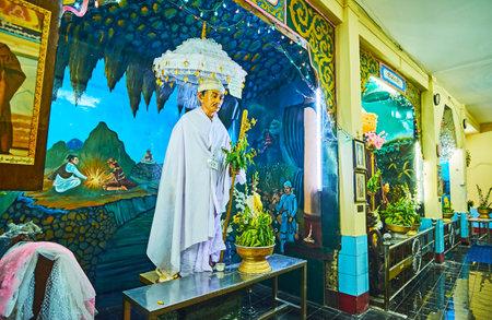 YANGON, MYANMAR - FEBRUARY 14, 2018: The white statue with umbrella in Nat shrine of Sule Pagoda, on February 14 in Yangon. Redactioneel