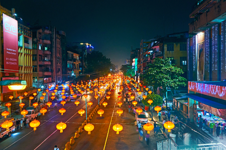 YANGON, MYANMAR - FEBRUARY 14, 2018: Evening Maha Bandula road is lighted with many bright lanterns - traditional decor to the Chinese New Year (Spring Festival), Chinatown, on February 14 in Yangon. Editorial