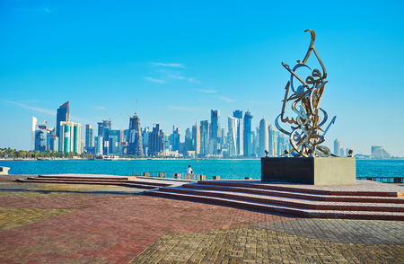 DOHA, QATAR - FEBRUARY 13, 2018:  The stainless steel Arabian letters are connected into the modern Calligraphy sculpture of Sabah Arbilli, located on Corniche promenade, on February 13 in Doha.
