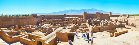 RAYEN, IRAN - OCTOBER 16, 2017: Tourists visit museum of ancient Arg-e Rayen - the adobe fortress with ruins of old town, located in desert of Kerman province, on October 16 in Rayen.