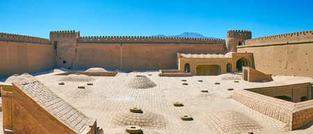 Restored courtyard of medieval Rayen Castle with domes of Governors mansion, located on the lower level, Iran. Stock Photo