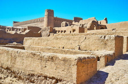The ruins of ancient walls in residential quarters of Rayen citadel, Iran.