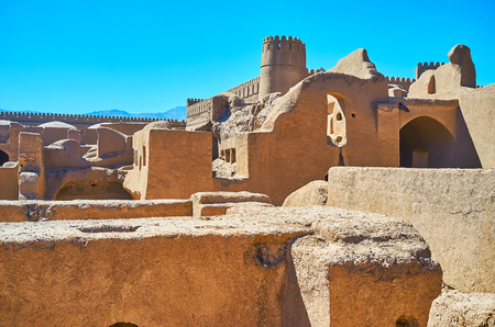 Visit historical Rayen citadel and walk in its ancient adobe quarters with ruined houses, workshops, barns and warehouses, Iran.