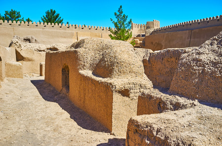 The maze of narrow and winding adobe streets of the ancient Rayen fortress, Iran.