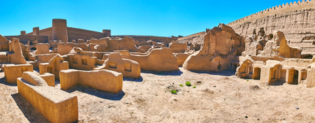Panorama of the residential quarters of ancient Arg-e Rayen citadel with preserved fooundations, housess walls, castle and tall ramparts, Iran. Stock Photo