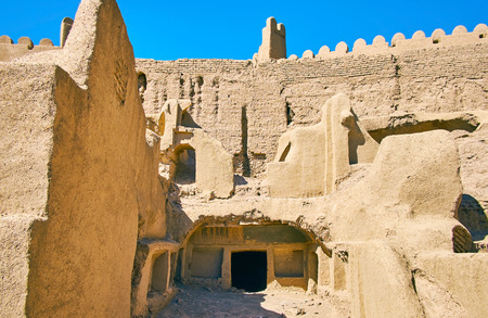 Visit the ancient adobe house at the rampart of deserted Rayen citadel, Iran.