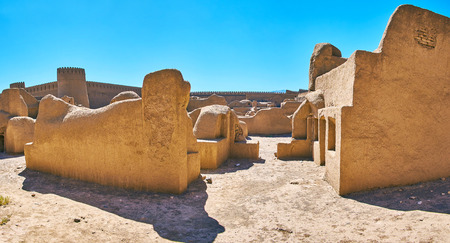 Walk along the street with ruined adobe buildings of Rayen fortress, Iran. Stock Photo