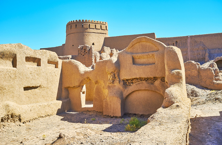 The view on Rayen castle through adobe wall of ruined house, Kerman Province, Iran. Stock Photo