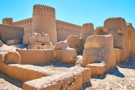 Walk among the clay ruins of living quarters of ancient Arg-e Rayen - famous deserted fortress of Kerman province, Iran.