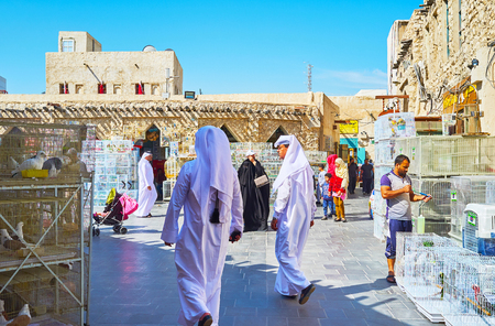 DOHA, QATAR - FEBRUARY 13, 2018: The historical Souq Waqif boasts birds market, popular among the locals and tourists, visiting it to watch the birds, on February 13 in Doha.