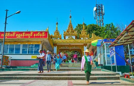 KYAIKTIYO, MYANMAR - FEBRUARY 16, 2018: The numerous Buddhist devotees visit the complex of Kyaiktiyo Pagoda, located on the mountain summit and containing relic of Buddhas Hair, on February 16 in Kyaiktiyo. Editorial