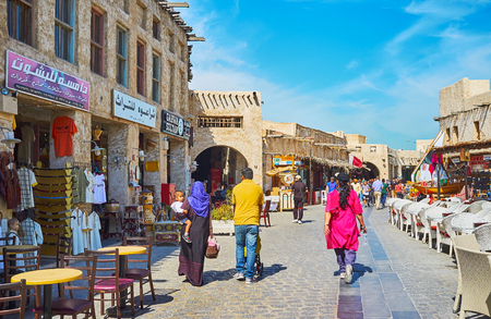 DOHA, QATAR - FEBRUARY 13, 2018: The old streets of Souq Waqif are best place to enjoy historic architecture, visit souvenir stores, cafes and choose something in market stalls, on February 13 in Doha Editorial