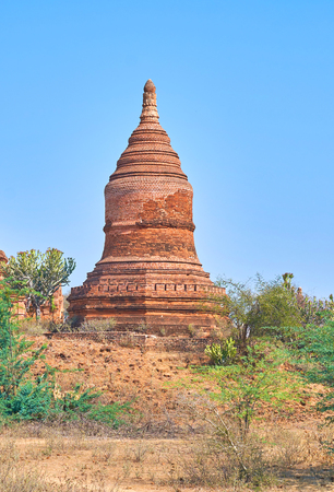 The view on beautiful restores ancient stupain Bagan archaeological site, Myanmar