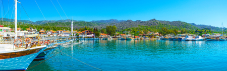Panorama of Ucagiz village, located on the coast of Kekova bay amid the islands, archaeological sites and ancient settlements, Turkey.
