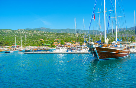 The large harbor of Ucagiz is always full of tourist yachts of local yachtsmen and foreign tourists, Kekova, Turkey.
