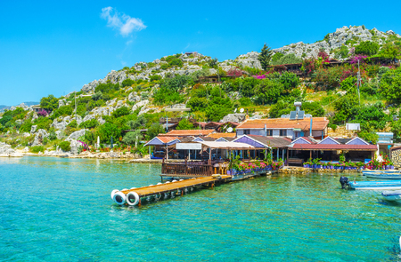 The restaurant complex on rocky coast of Kalekoy village has its own pier for yachts and tourist pleasure boats, Kekova, Turkey.