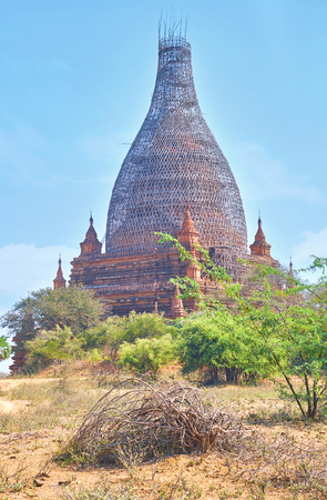 The Somingyi temple with scaffolding covering the dome during restoration, Bagan, Myanmar Archivio Fotografico