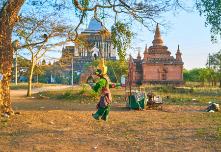 Beautiful traditional burmese puppet hanged on the tree in Bagan archaeological park, Myanmar