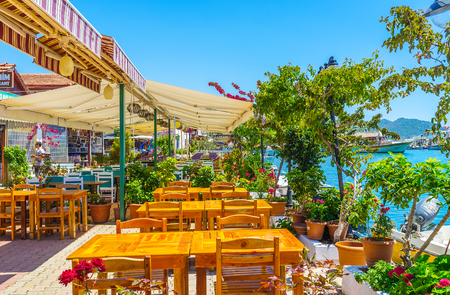 KEKOVA, TURKEY - MAY 10, 2017: The center of the tourist village is occupied with nice restaurants of local cuisine, offering fresh fish dishes and refreshing drinks, on May 10 in Kekova. Editorial