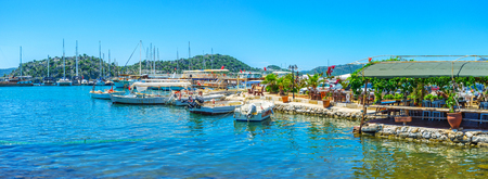 KEKOVA, TURKEY - MAY 5, 2017: Ucagiz village is the popular tourist destination on the coast of Kekova Bay, it has large harbor and offers boat and yacht trips to the landmarks of the Bay, on May 5 in Kekova. Editorial