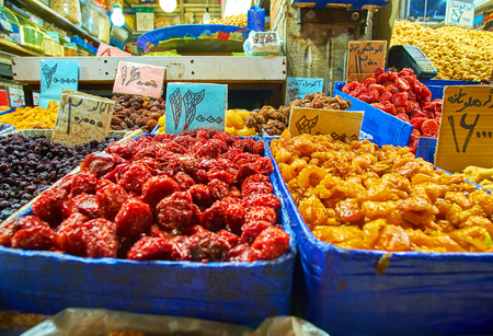 The stall at Grand Bazaar offers variety of eastern sweet dried fruits on each taste, Tehran, Iran