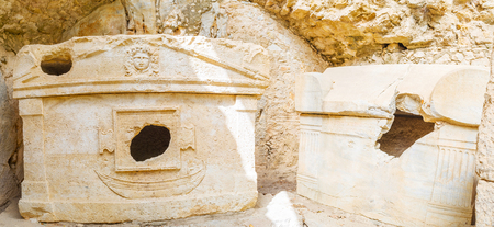The ruins of carved stone sarcophagus of captain Eudemos in small niche in rock, Olympos archaeological site, Turkey