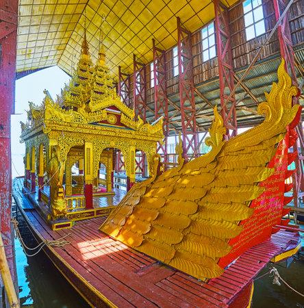 INLE LAKE, MYANMAR - FEBRUARY 18, 2018: The backside of the Festive Royal boat (Karaweik) of Hpaung Daw U Pagoda, Ywama village, on February 18 in Inle lake.