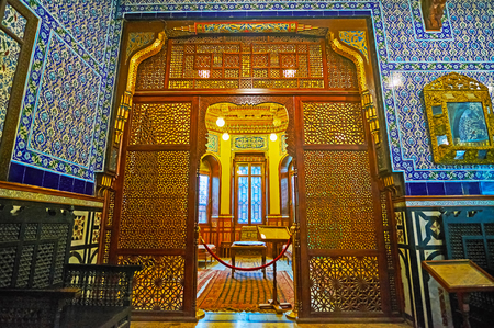 CAIRO, EGYPT - DECEMBER 24, 2017: The masterpiece Arabian screen with fine carved Islamic patterns separates two chambers in Residence of Manial Palace, on December 24 in Cairo