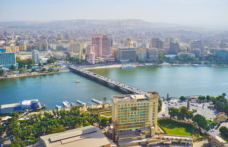 Aerial view on Qasr el Nil bridge between Gezira Island and Downtown district of Cairo, famous for European architecture, wide streets and business centers, Egypt.
