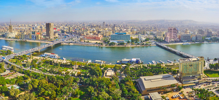CAIRO, EGYPT - DECEMBER 24, 2017: Aerial view of Downtown district from Gezira Island, separated by Nile river, on December 24 in Cairo