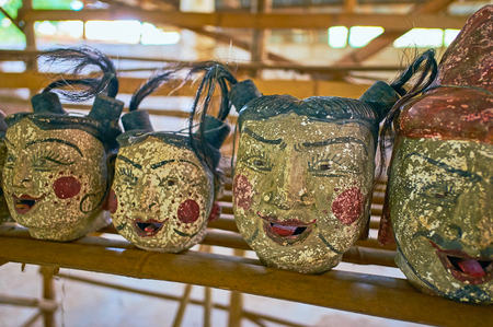The antique heads of worshiped in Myanmar spirits, named nats in market of Inn Thein (Indein) village on Inle Lake. Reklamní fotografie