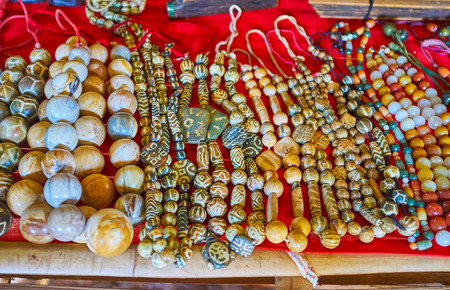 Traditional stone beads, decorated with ancient tribal patterns are perfect gifts from Myanmar, Inn Thein village market on Inle Lake.