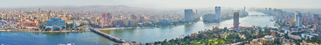CAIRO, EGYPT - DECEMBER 24, 2017: Wide panorama of cityscape from Cairo Tower on Gezira Island, overlooking city districts and Nile river, on December 24 in Cairo. Editorial