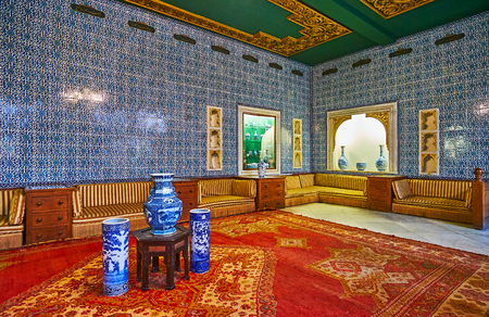CAIRO, EGYPT - DECEMBER 24, 2017: The gifts hall of Manial Palace with blue tiled patterns on walls, niches for porcelain vases and statuettes, on December 24 in Cairo