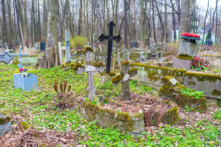 SAINT PETERSBURG, RUSSIA - APRIL 26, 2015: The abandoned tombs in Smolensk cemetery, one of the oldest in the city, on April 26 in S. Petersburg