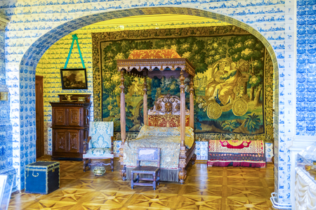 SAINT PETERSBURG, RUSSIA - APRIL 26, 2015:  Menshikov Palace was the most richly decorated edifice of its time, it boasts expensive chineese tapestries, painted Dutch tiles and luxury wooden furnitures, on April 26 in S. Petersburg Editorial