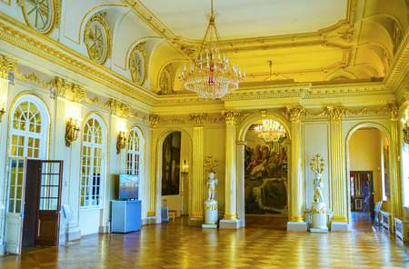SAINT PETERSBURG, RUSSIA - APRIL 26, 2015: The Great Hall of Menshikov Palace richly decorated with carved gilded stucco and marble sculptures, April 26 in S. Petersburg