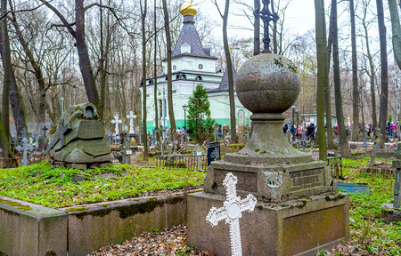 SAINT PETERSBURG, RUSSIA - APRIL 26, 2015: The old cemetery boasts the small chapel of the Blessed Xenia of Petersburg, very revered Saint among orthodox parishioners, on April 26 in S. Petersburg