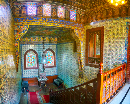 CAIRO, EGYPT - DECEMBER 24, 2017:  Reception Palace of Manial complex has two stories, connected by scenic hall with ornate tilework, stained-glass windows and carved wooden staircase, on December 24 in Cairo Editorial