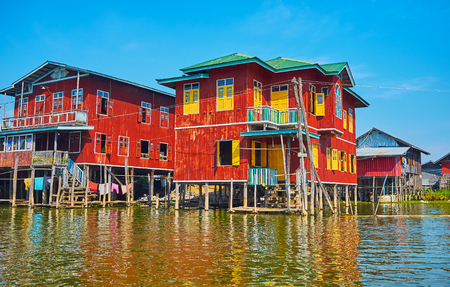 Dense residential stilt houses in Inpawkhon village - popular tourist place with numerous handicraft workshops, Inle Lake, Myanmar. Redakční