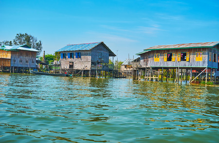 The stilt houses on Inle Lake are built of timber or weaved bamboo, the poorest are not painted, Inpawkhon, Myanmar.