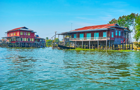Inle Lake is popular for its stilt villages with traditional colored wooden houses and fast kayaks, Inpawkhon, Myanmar.