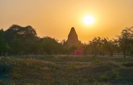 The scenic view on silhouette of ancient pagoda in sunset lighting, Bagan, Myanmar