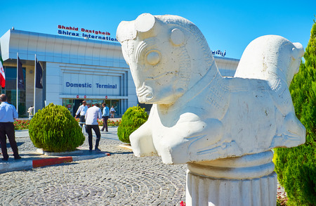 SHIRAZ, IRAN - OCTOBER 15, 2017: The garden in front of  Shiraz Shahid Dastgheib International Airport is decorated with copy-sculpture of double-headed horse - the famous artifact from Persepolis archaeological site, on October 15 in Shiraz. 報道画像