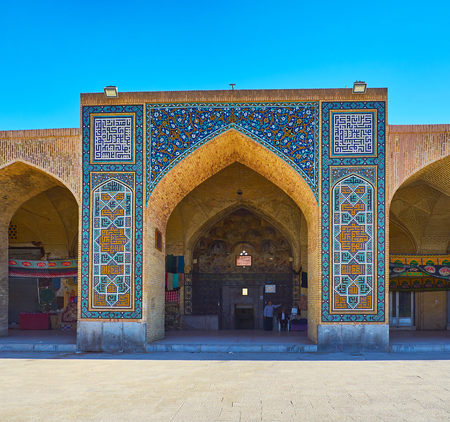 KERMAN, IRAN - OCTOBER 15, 2017: The iwan (portal) of Ganjali Khan Hammam (bathhouse) is decorated with fine floral and authentic geometric patterns on ceramic tiles, on October 15 in Kerman.