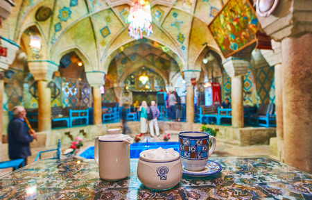KERMAN, IRAN - OCTOBER 15, 2017: Traditional coffee in Vakil restaurant - the former bathhouse, located in Ganjali Khan complex, on October 15 in Kerman.