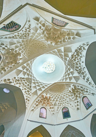 KERMAN, IRAN - OCTOBER 15, 2017: The white dome of  Ganjali Khan Bathhouse with beautiful plasterwork, including muqarnas decorations, on October 15 in Kerman.